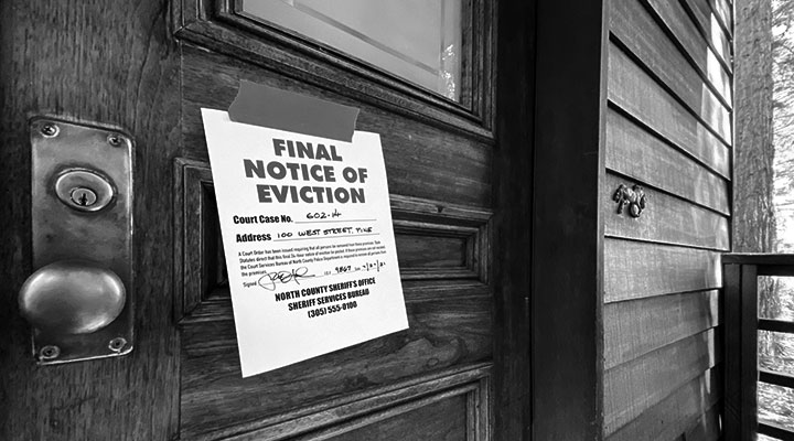 A photo of an eviction notice on a door