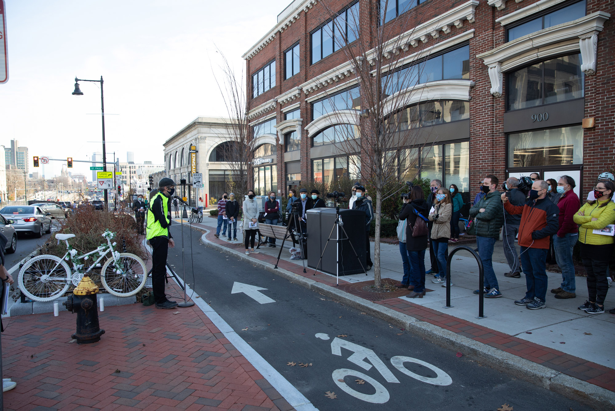 A gathering of family, friends, city officials, bicycle advocates, and others from the BU community filled the sidewalk on Saturday, November 21, 2020, to celebrate the life of Christopher Weigl with a memorial ghost bike installation ceremony on the corner of Commonwealth Avenue and St. Paul Street in Boston, where he was killed on his bike by a truck driver in December of 2012.