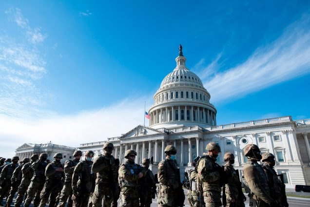 A photo of National Guard troops in front of the US Capitol