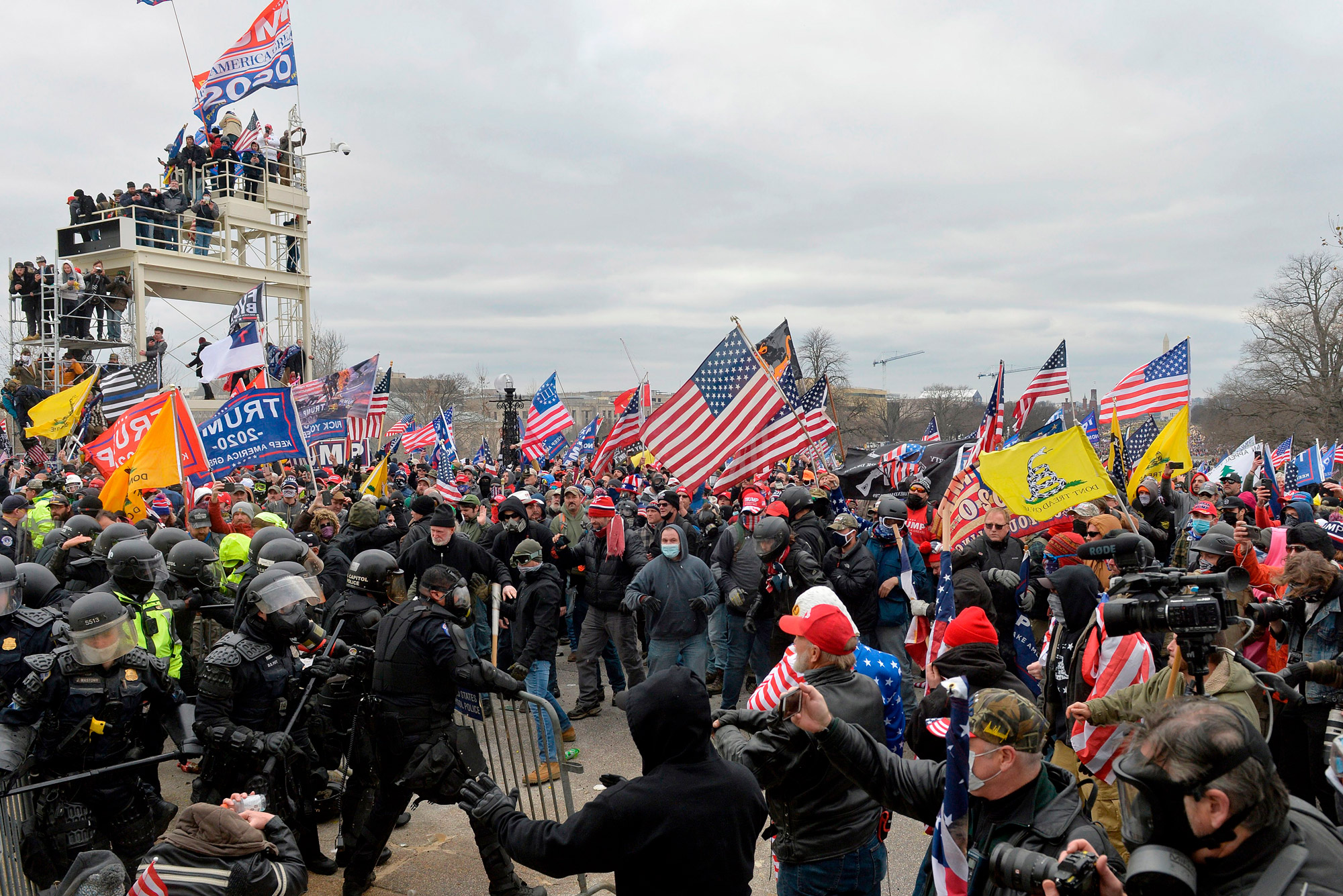 A photo of a mob of rioters clashing with police in front of the US Capitol on January 6, 2020