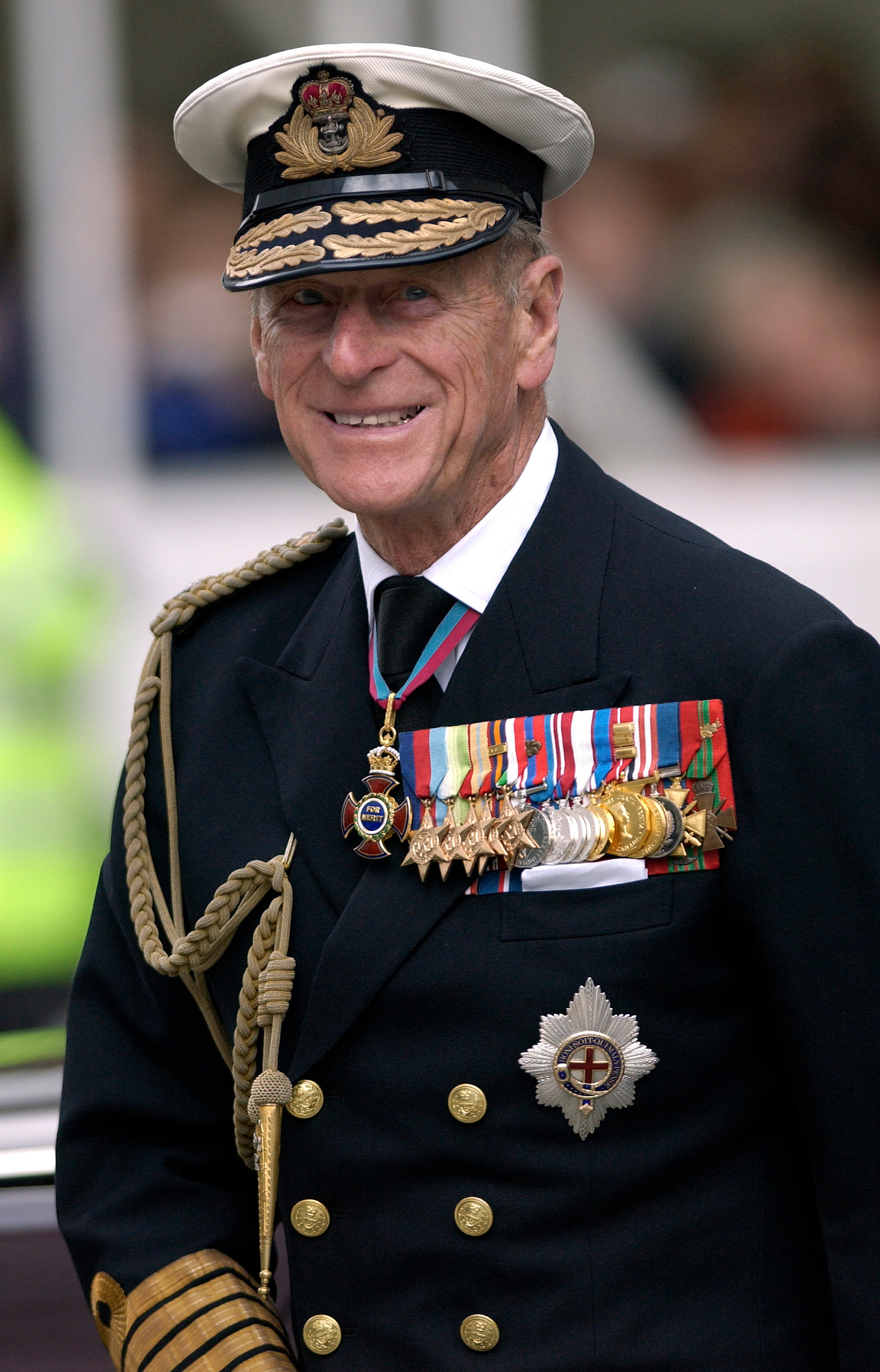 A photo of Prince Philip in dress uniform. He is smiling at the camera.