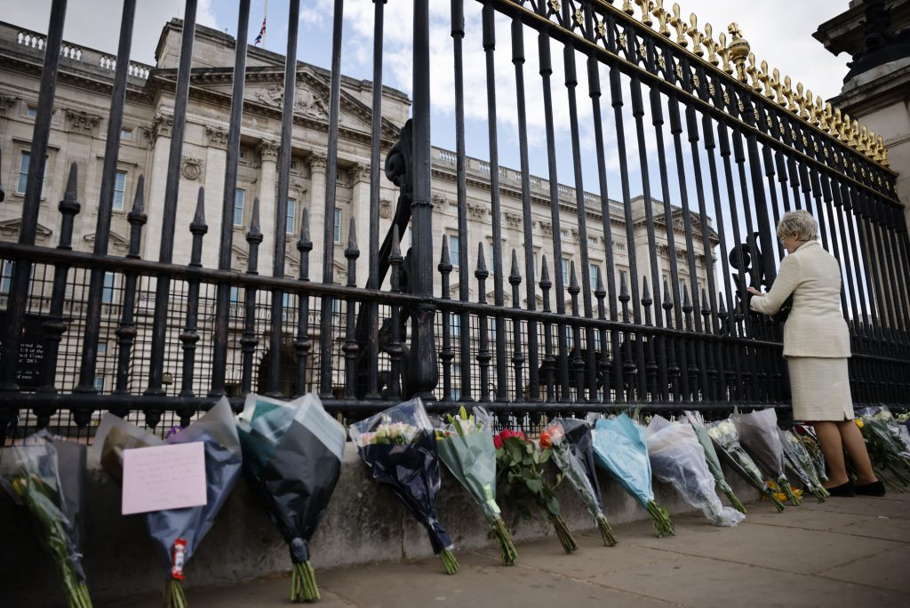 A photo of flowers lining a fence outside of Buckingham Palace in honor of Prince Philip.