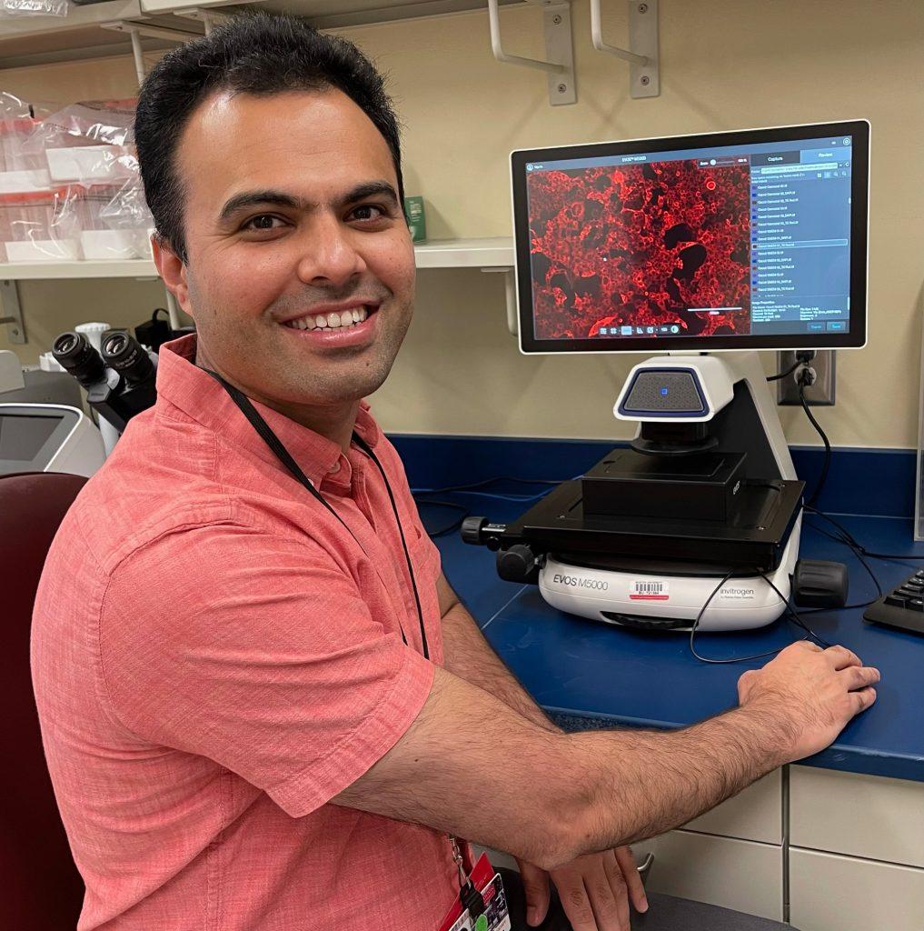 A photo of Mohsan Saeed working at a computer