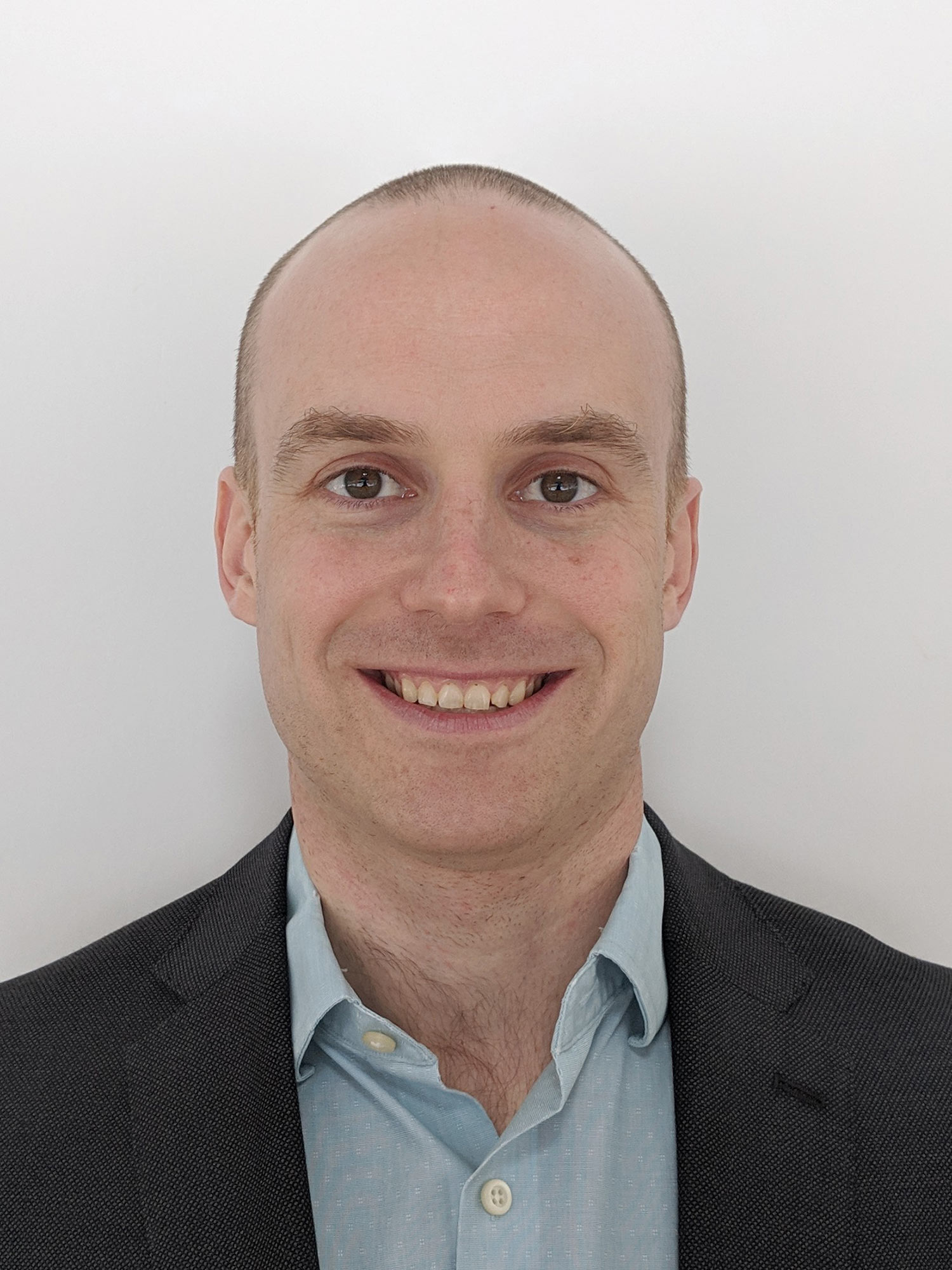 Headshot of Adam Fox, MassMutual's head of data, in a blue jacket and light blue button-down shirt.