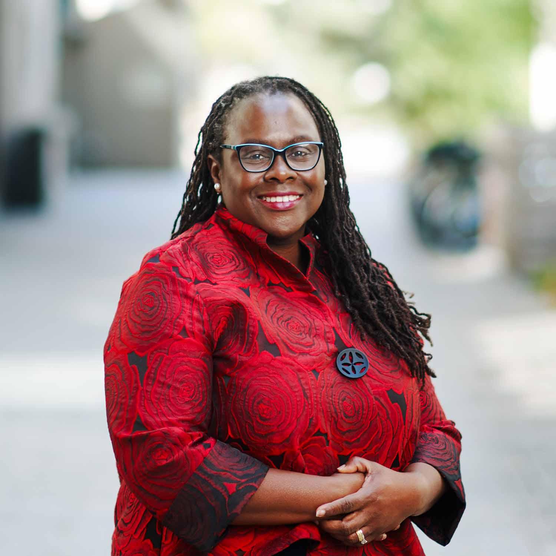 Portrait of Angela Onwuachi-Willig standing outside the Boston University School of Law.