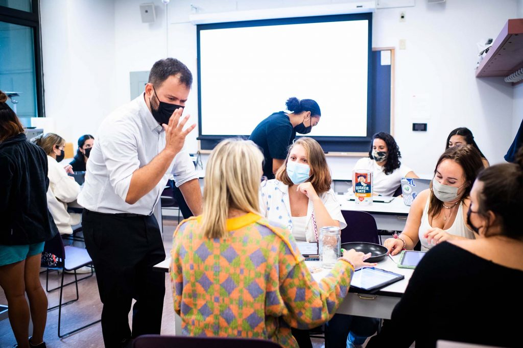 Professor Pedro Almeida works with students in an advanced skills course at Sargent College on the first day of classes, September 2, 2021.