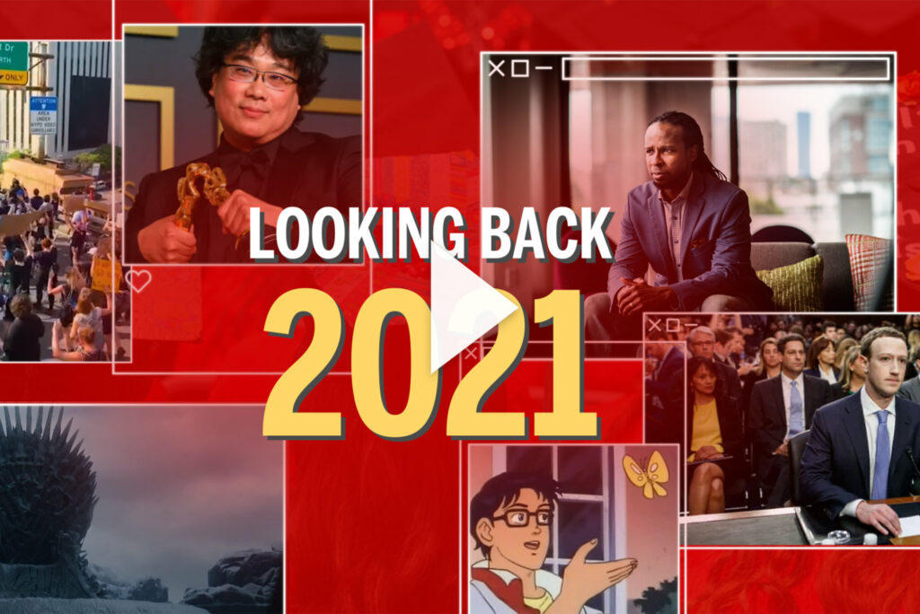 "Graphic with photos of key moments from the past four years on a red background that says ""Looking Back 2021"" with a play button overlaid. The photos include the butterfly meme, Mark Zuckerberg, Ibram X. Kendi, director Bong Joon-ho winning an academy award, and a screenshot from game of thrones."