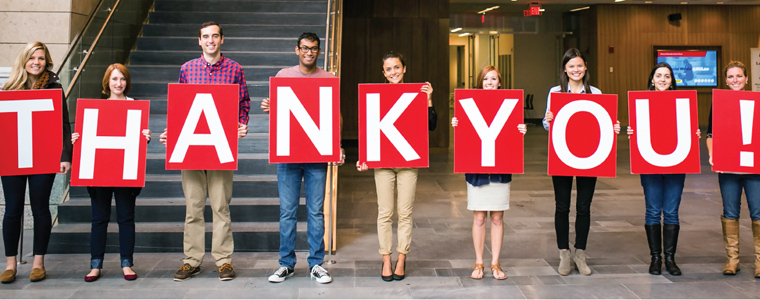 BU Law students holding a thank you sign