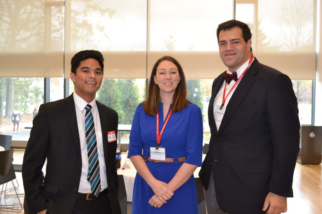 Three people posing for a photo in the Tax Careers Luncheon