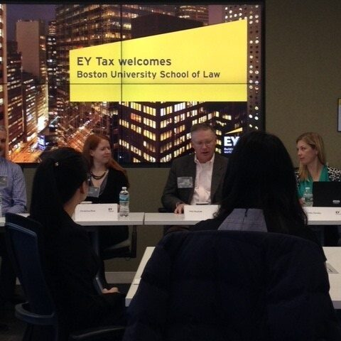 The panel and audience in EY Tax event