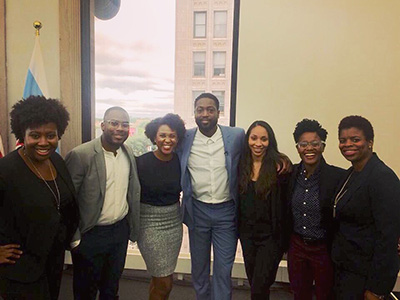 Kevin Smith ('18) and his Pitch Black team with Dwayne Wade. From left to right: LaToya Marc, Harvard Business School ('17); Smith; Kristen Bryant, product manager at Wistia; Wade; Ashley Terrell, Harvard Business School ('17); Lanisha Blount, Harvard Graduate School of Design ('17); Sayiddah McCree, Harvard Business School ('17)