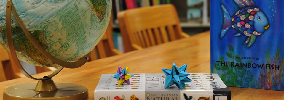Image of books, a globe, and origami stars