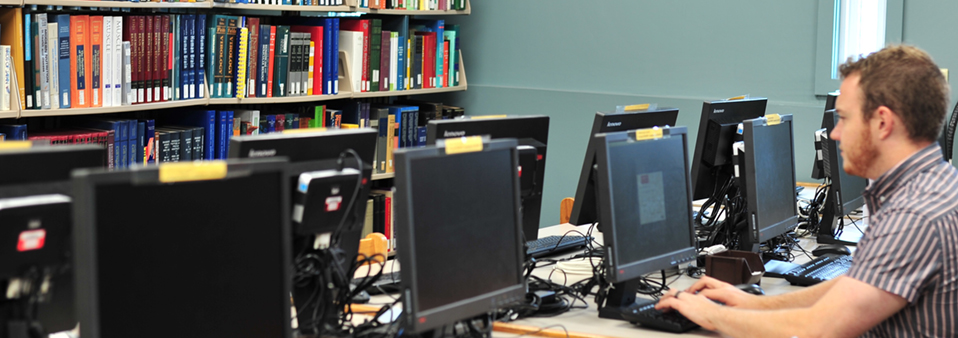 Image of a student using a computer in the Science & Engineering Library