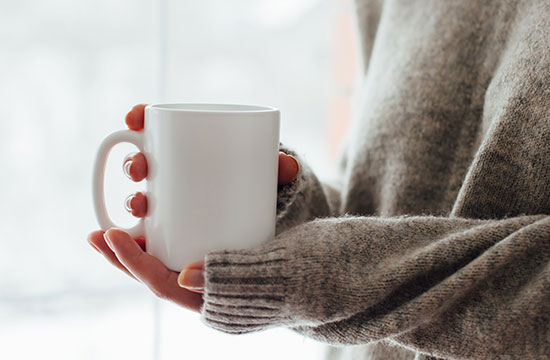 woman holding coffee mug