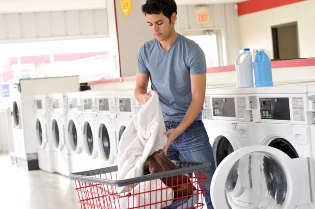 Moving off campus can mean doing your own laundry, as seen here. (Photo from iStockPhoto.)