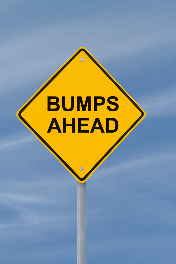 "A road sign that reads ""Bumps Ahead"""