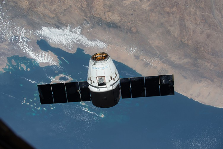 SpaceX Dragon private cargo spacecraft in space during its first mission to the International Space Station