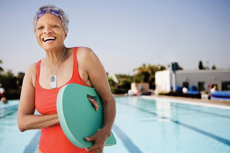Healthy senior with swimming board
