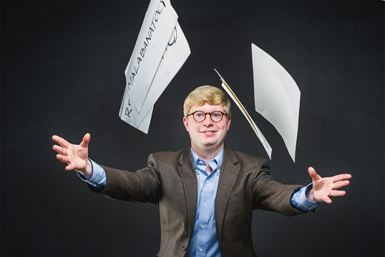 Tyler Perrachione, Director of Boston University Sargent College Communication Neuroscience Research Laboratory, holds a card showing a word used in the nonword repetition tests studying language disorders and phonological working memory in the dyslexic brain