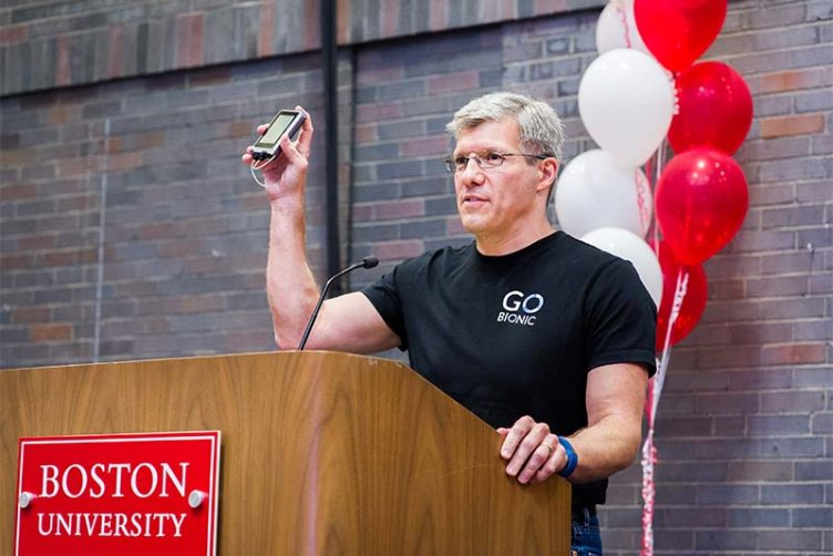 Edward Damiano holds a prototype of the iLet bionic pancreas he developed during an acceptance speech for the Boston University Innovator of the Year Award