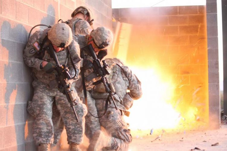 Officers of 1st Stryker Brigade Combat Team, Ready First 1st Armored Division, participate in an urban combat exercise at a training facility on Fort Bliss, Texas.