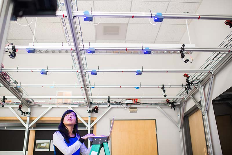 phd candidate emily lam works with smart lighting sensors as part of thomas research with