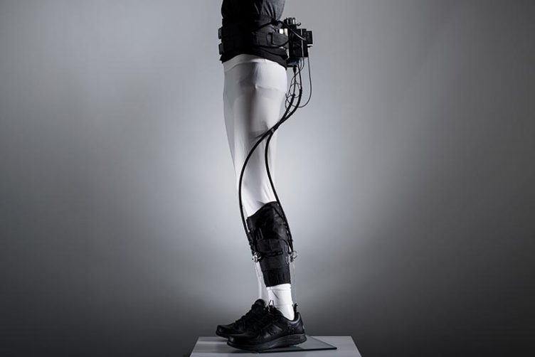 A medical exosuit designed to help stroke victims walk is displayed on a mannequin