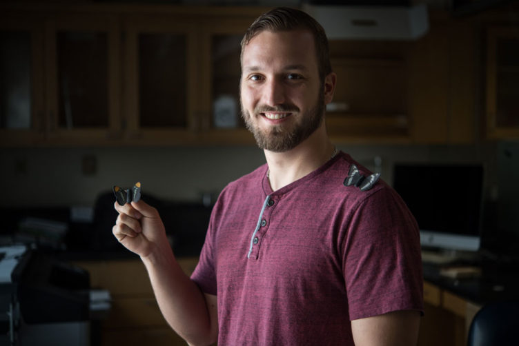 PhD candidate Evan Kristiansen (GRS'20). Kristiansen and his advisor, associate professor of biology Sean Mullen, study butterflies to understand the genetics of speciation. Photo by Cydney Scott