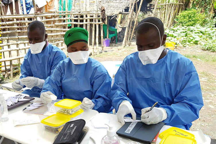 Clinicians work at an Ebola Virus vaccination clinic in Mbandaka, Democratic Republic of Congo, during an outbreak in May of 2018