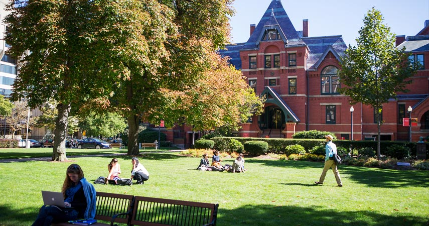 Photo of students on the lawn in front of the Talbot Building