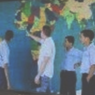 Students in front of map