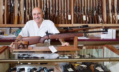 Gun store owner behind counter