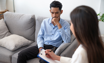 A man talking with a counselor