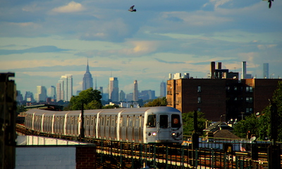 Elevetated F train in Brooklyn, with Manhattan skyscrapers in the distance