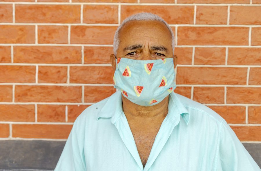 Older man wearing face mask to prevent spread of coronavirus